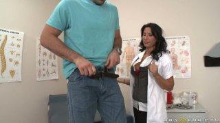 Filthy brunette doctor Lezley Zen gives handjob and facesits image