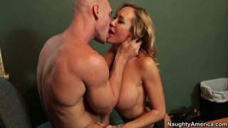 Delicious blonde MILF Brandi Love blows and gives titjob image