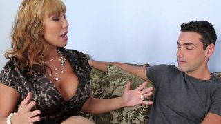 Curly chick Ava Devine provides a stiff dick with a stout blowjob image