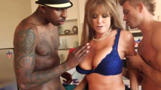 Horny busty mommy Darla Crane is fucked hard in her throat and pussy image
