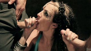 Slutty bellydancer Alektra Blue chokes on a cock while another man eats her asshle and pussy image
