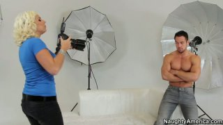 A horny photographer Lylith LaVey seduces the model and sucks his cock right on the photo shoot image