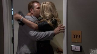 Blond head Jessica Drake wins a cock in the elevator and sucks it with delight image