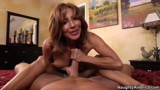 POV video of mature mommy Tara Holiday giving blowjob and footjob image