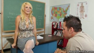 Horny milf teacher Charlee Chase seduces her student and gives him a head image