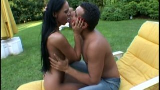 Whorable and torrid black head Christina Bella sucks a cock in the yard image
