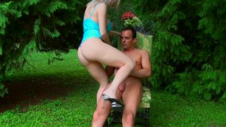 Pale_blond_head_Isabella_Clark_rides_a_cock_on_the_deck_chair image