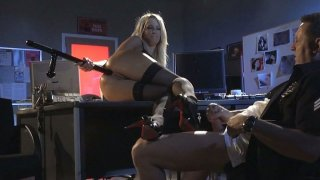 Cop rams pussy and asshole of Jessica Drake in the police station image