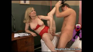Image: Blonde businesswoman Nina Hartley gets her pussy and asshole rammed