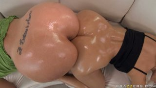 Two oiled shining butts touching each other image