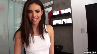 Cute and sexy brunette Casey Calvert gives a blowjob in_the bathroom image
