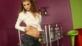 Curly Juliette Shyn strip teases demonstrating her skinny butt image
