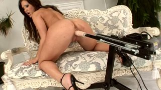 Image: Dildo machine fucks busty Angie Knight on the couch