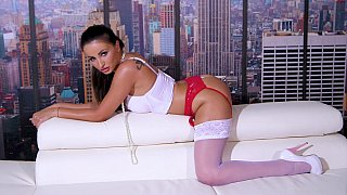 Bronzed beauty shows off on cam image