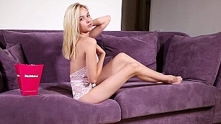 Solo on a couch with a slim natural tits blonde image