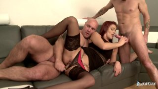 French redhead MILF knows how to handle two enormous dicks image