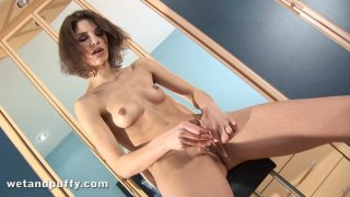 Hot Demi gets naked and wets her pussy for masturbation image