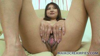 Image: Nasty slut Yasuko Yoshii pinches her nipples and stretches her hairy pussy