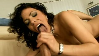 Lustful brunette mommy Naomi Bell blows hard dick on the couch image