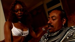 Delicious ebony babe Marie Luv blows dick of a mature guy image