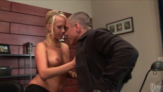 Horny blonde cutie Carla Cox gives blowjob to her boss in the office image