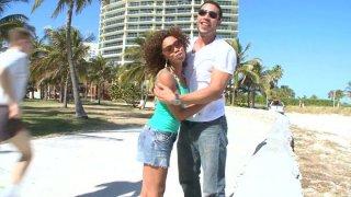 Curly mulatto Misty Stone seduces a man on the beach image