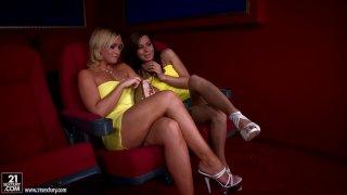 Slutty lesbians Kathia Nobili & Cipriana please each other in the cinema image