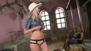 Image: Horny cowgirl Blond Cat blows the black cock in the barn