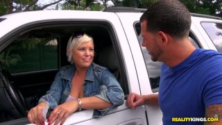 Busty cute milf gets picked up in the car wash and flashes her tits image