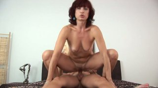 Pretty mature redhead Wanda pleases young cock on the bed image