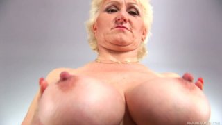 Buxom BBW granny Janka gives solo masturbating performance image