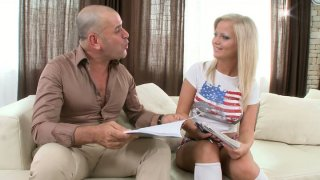 Buxom blonde starlet Sunny Diamond gives_blowjob on the couch image
