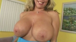 Extremely busty blonde mom Amber Lynn gets her boobs oiled image