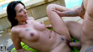 Voracious Zoey Holloway furiously fucks outdoors image