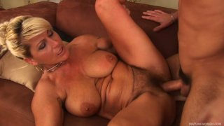 Blonde mature trollop Berna gets banged by a guy of half of her age image