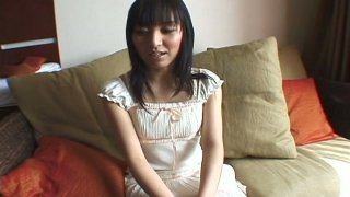 Nasty brunette gal Mami Kato plays with high powered vibrator image