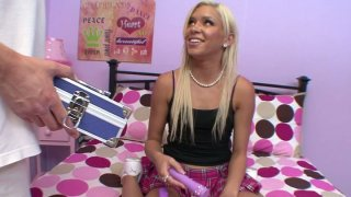 Teeny blonde gal Kacey Jordan_receives present from Mark Wood image
