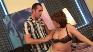 Fillthy BBW MILF Orgianna gives head to her stud Ryan image