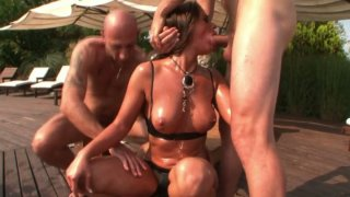 Cathy Heaven gets involved in a hardcore group fuck near the pool image