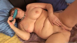 Ugly obese MILF Morgianna pets her cunt with vibrator image