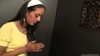 Submissive and modest chick Lyla Storm sucks a cock in the confessional room image