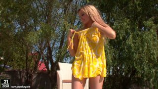 Wet and horny blondie Faye Barts stripteases in the pool image