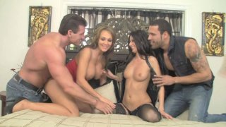Scorching sex goddess Nikki Daniels gets her twat drilled in foursome image