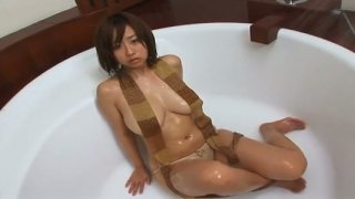 Busty brunette Jap chick Hitomi Kitamura all soaped up for show image
