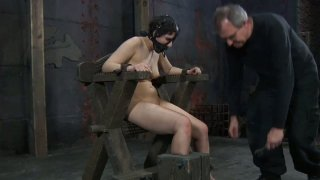 Pallid BDSM fan Marina gets tied_up and wears a slave hood image