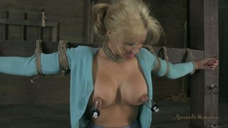 Tanned busty blondie Phoenix Marie is attached to the bar and sucks a cock image