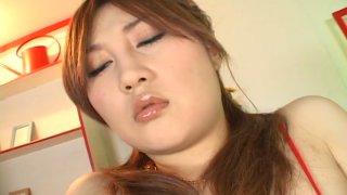 Perky Japanese slut Hiyori Konno masturbates with a dildo in a solo sex video image