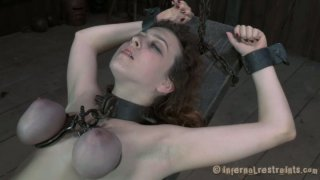 Nasty chick Dixon Mason is starring_in a hardcore BDSM video produced by Infernal Restraints image