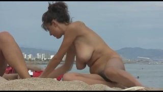 Spy video featuring nude girls on Barcelona beach image