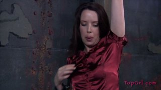 Image: Curvaceous MILF in red dress gets punished in the lair of BDSM